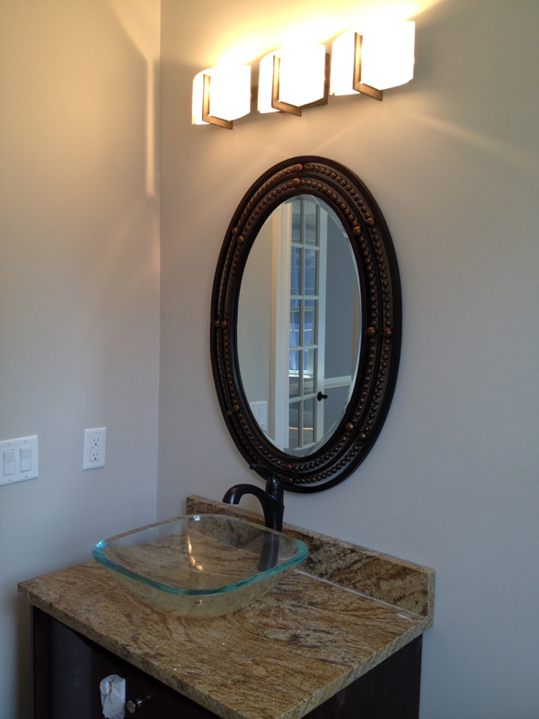 Framed beveled oval mirror