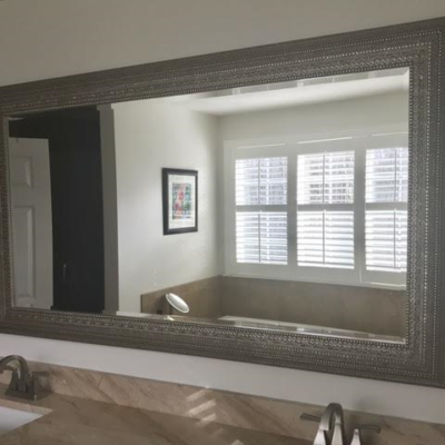 Uttermost framed beveled mirror on vanity