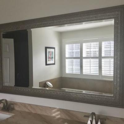 Uttermost framed beveled mirror on vanity