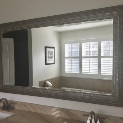 Residential Glass - Uttermost framed beveled mirror over vanity