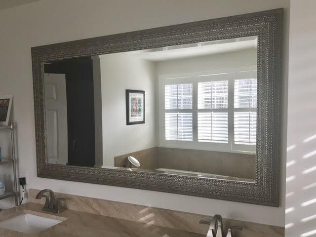 Residential Glass - Uttermost framed beveled mirror over vanity