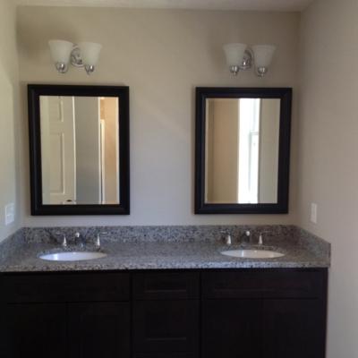 Black framed beveled mirrors