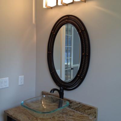 Framed beveled oval mirror