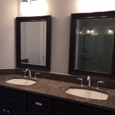 Uttermost black framed beveled mirror